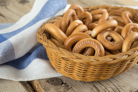 boublik: Bagels in a basket with napkin on an old wooden table Stock Photo