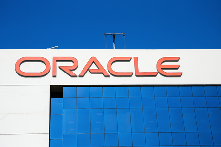 DUBAI, UAE - DECEMBER 1, 2017: Sign of oracle on the office building
