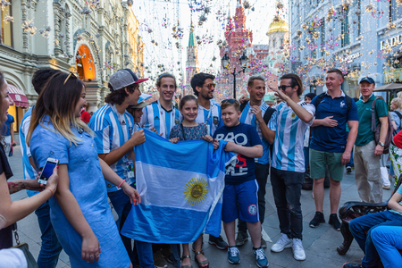 MOSCOW, RUSSIA - June 16, 2018: Football fans with the flag of Argentina on Nikolskaya street
