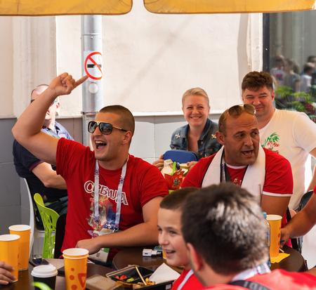 MOSCOW, RUSSIA - June 27, 2018: Football fans  in the bar on Nikolskaya street