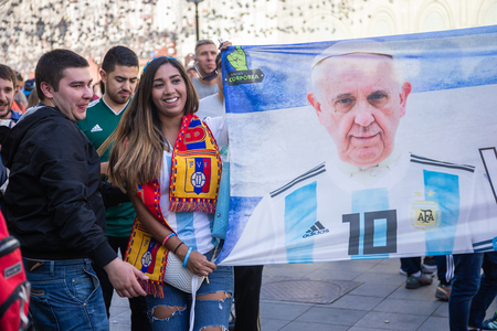 MOSCOW, RUSSIA - June 15, 2018: FIFA WORLD CUP Football Fans with a flag with the image of the Pope on Nikolskaya street Редакционное