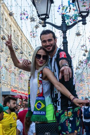 MOSCOW, RUSSIA - June 16, 2018: Football brazil fans on Nikolskaya street Редакционное