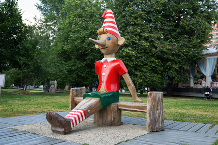 MOSCOW, RUSSIA - June 19, 2018: Wooden sculpture of Buratino (Russian Pinocchio)in the park