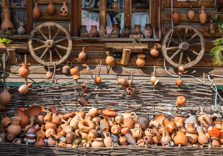 Wall of a country house with household utensils Banco de Imagens