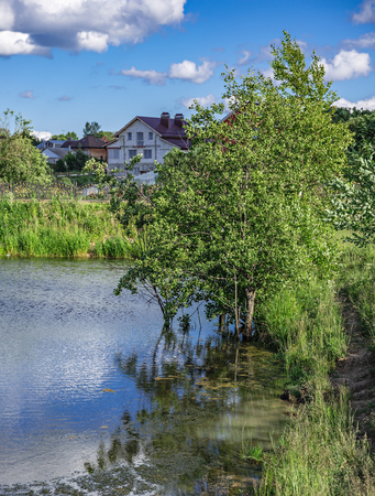 Landscape with a lake in the countryside in Russia Stock Photo