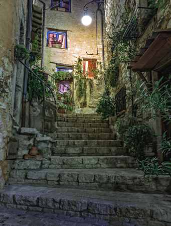 Narrow street  in the old village Tourrettes sur Loup at night, France. Stock Photo