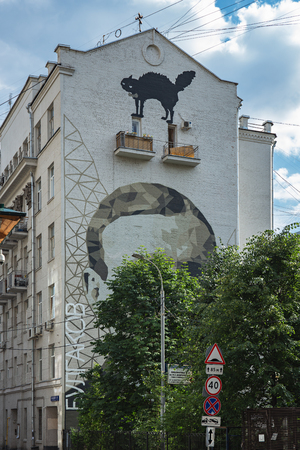 MOSCOW, RUSSIA - JUNE 17, 2018: Portrait of a Russian writer and playwright Mikhail Bulgakov on the wall of apartment building Editorial