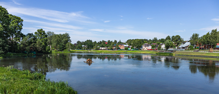 Panorama Landscape with a lake in the countryside in Russia