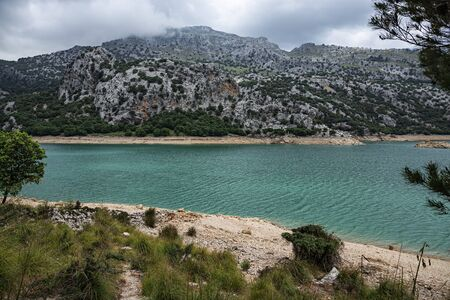 Picturesque landscape with a turquoise lake in the mountains of Tramontana on the island of Mallorca