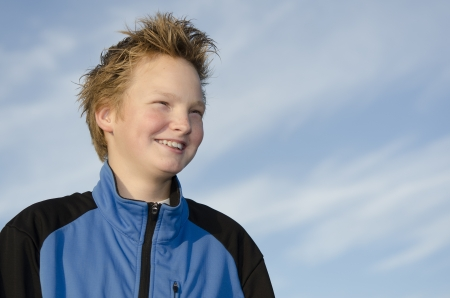 Portrait of laughing youngster against blue sky background Stock Photo - 16716982