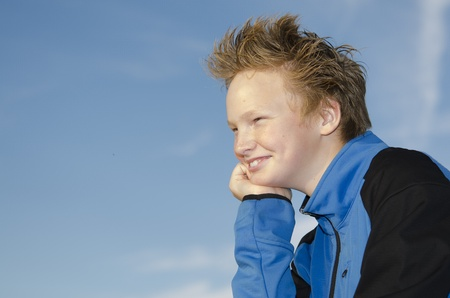 Portrait of guy with spiky hairstyle against blue sky background Stock Photo - 16716978