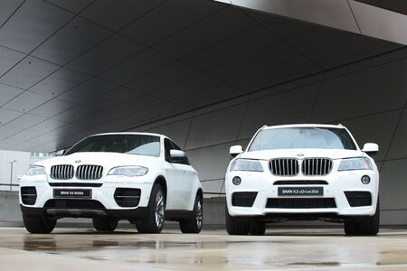 MUNICH - SEPTEMBER 19: Two new models BMW X-series at BMW Welt Expo center on September 19, 2012 in Munich.