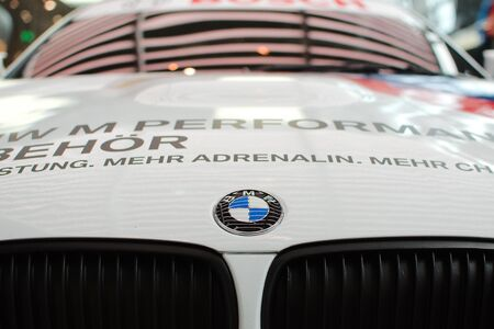 MUNICH - SEPTEMBER 19: BMW Logo on the front of the new BMW sport car demonstrated at BMW Welt Expo center on September 19, 2012 in Munich Editorial