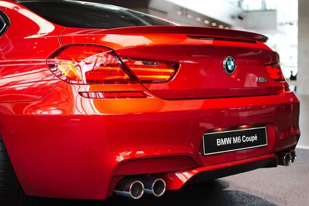 MUNICH - SEPTEMBER 19: New model BMW M6 Coupe at BMW Welt Expo center on September 19, 2012 in Munich Editorial