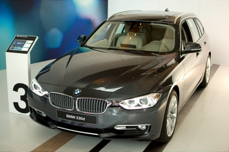 MUNICH - SEPTEMBER 19: New model BMW 330d at BMW Welt Expo center on September 19, 2012 in Munich