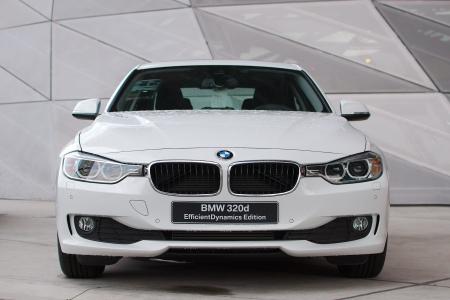 MUNICH - SEPTEMBER 19: New model BMW 320d EfficientDynamics at BMW Welt Expo center on September 19, 2012 in Munich Editorial