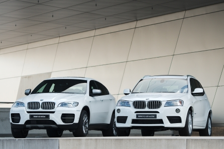 MUNICH - SEPTEMBER 28: Two new models BMW X-Series at BMW Welt Expo center on September 28, 2012 in Munich Editorial