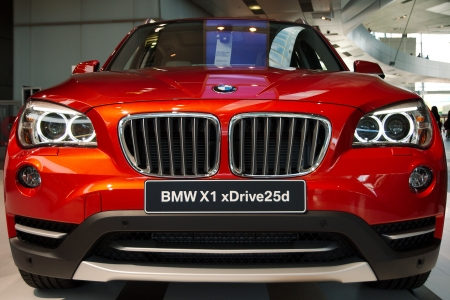 MUNICH - SEPTEMBER 19: New model BMW X1 xDrive25d at BMW Welt Expo center on September 19, 2012 in Munich Editorial