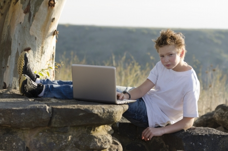 Serious teen rest with notebook on nature Stock Photo - 17018463