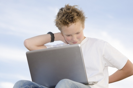 Fair-haired pretty guy rest with laptop in nature Stock Photo - 17018458