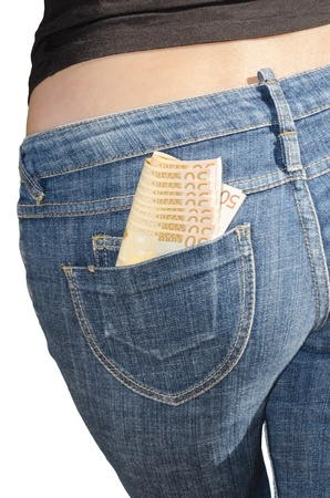 Bundle of money in back pocket of female jeans isolated on white photo