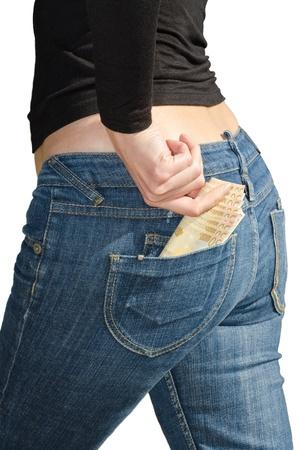 Beautiful young woman pulls out euro banknotes from back pocket isolated photo