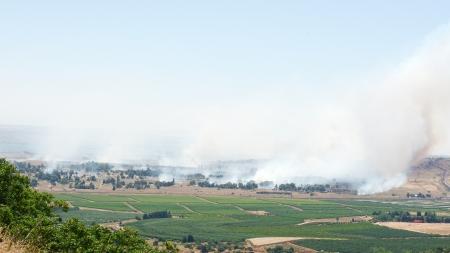 6 juni: Vuur en rook - de oorlog in Syrië in de buurt van de Israëlische grens op 6 juni 2013 in Qunaitira, Syrië