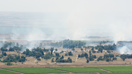 the borderline: JUNE 06: Artillery fire in Syrian city Al Qunaytirah on Golan Heights on June 06, 2013 in Syria