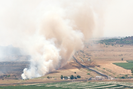 JUNE 06: Fire after shelling on battlefield in Syria on June 06, 2013 in Qunaitira, Syria