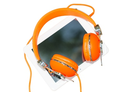 White tablet PC and orange headphones isolated on white photo