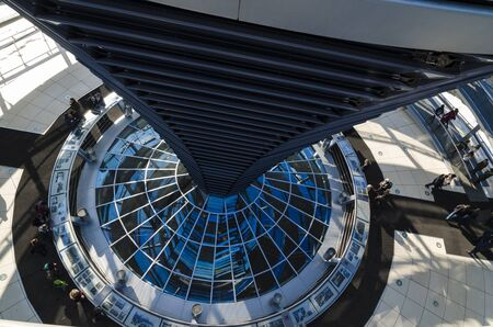 BERLIN - MARCH 16: Architectural details of Reichstag dome on March 16, 2013 in Berlin. The Reichstag dome is a large glass dome with a 360 degree view of the surrounding Berlin cityscape.