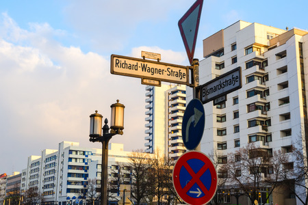 Signpost with waymark in sleeping quarter of evening lighted Berlin photo