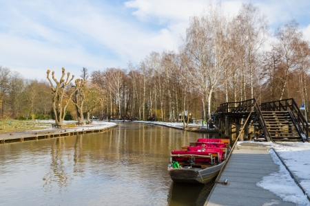 Boat near the pier on springtime canal in european national park photo