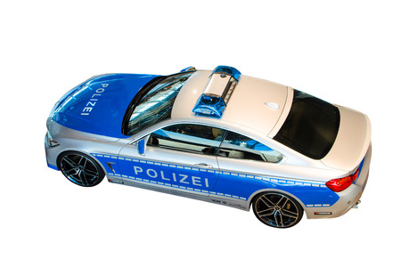 MUNICH, GERMANY - DECEMBER 27, 2013  New model 2014 of German police patrol car, presented in BMW welt show  Isolated on white
