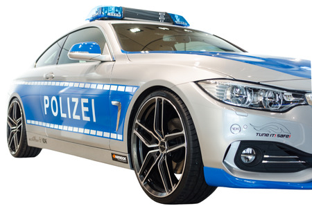 MUNICH, GERMANY - DECEMBER 27, 2013  New model 2014 of German police urban patrol car, presented in BMW welt show  Isolated on white
