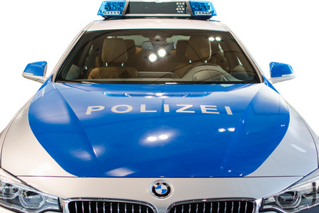 MUNICH, GERMANY - DECEMBER 27, 2013  New modern model of German police duty patrol BMW car  Closeup front view isolated on white