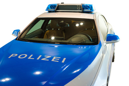interceptor: MUNICH, GERMANY - DECEMBER 27, 2013  German police patrol car  New modern BMW model, presented for use in 2014  Isolated on white