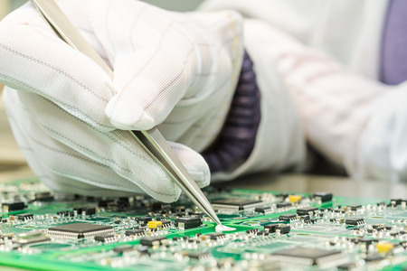 electronics: Engineering and electronic component quality control in QC lab on computer PCB turnkey manufacturing  Stock Photo