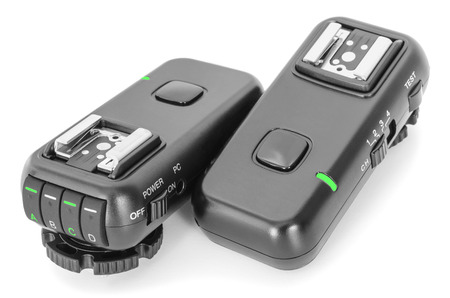ttl: Remote wireless control radio trigger set for studio flash lights isolated on white