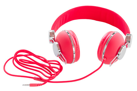 Vibrant red wired headphones isolated on white background