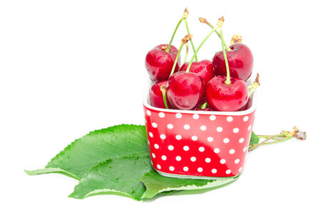 Natural organic summer nutrition for vegetarian gourmet big ripe cherry berry wet fruits in small square bowl dish isolated on white