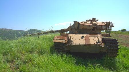 Destroyed rusty tank on battlefield near the Israeli Syrian border  HDR photo  photo