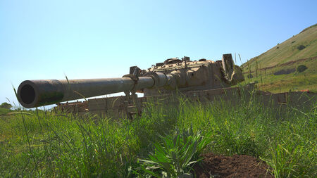 Large-caliber gun on old destroyed tank beside the Syrian border  HDR photo  photo