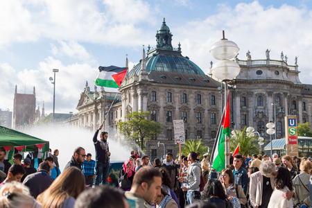 pleas: MUNICH, GERMANY - AUGUST 16, 2014: Demonstration in support of Palestine in the center of Europe. European activists demand the cessation of hostilities in Gaza Strip.
