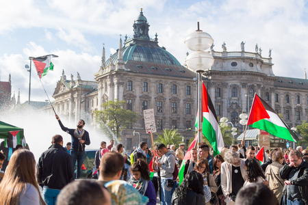 pleas: MUNICH, GERMANY - AUGUST 16, 2014: Peaceful demonstration for stopping Israel-Palestine conflict and ceasefire in Gaza Strip. Activist group calls negotiations between the warring parties.