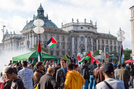 pleas: MUNICH, GERMANY - AUGUST 16, 2014: Pro-Palestinian demonstration in the central square of European city. Demonstrators are asking the German government for assistance in ending the Arab-Israeli conflict, and end the war in Gaza. Editorial