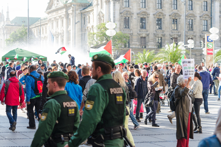 MUNICH, GERMANY - AUGUST 16, 2014: German police to maintain order on the pro-Palestinian demonstration. European activists demand freedom and independence for the people of Gaza and to stop the war.
