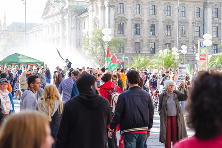 MUNICH, GERMANY - AUGUST 16, 2014: Inscription on the poster: Freedom for Palestine - Peace for Israel. European activists demand to withdraw the war in Gaza and end the Palestine occupation. Editorial