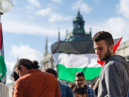pleas: MUNICH, GERMANY - AUGUST 16, 2014: Young European activists at the demonstration. Demonstrators demanding that the government to exert pressure on Israel to end the fighting in the Gaza Strip and the withdrawal from the occupied Palestinian territories.