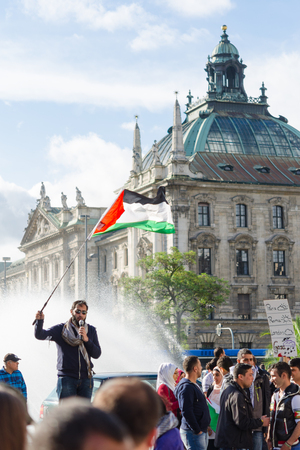 pleas: MUNICH, GERMANY - AUGUST 16, 2014: Palestinian demonstration in the center of the European Union. The protesters are demanding the release of the occupied Palestinian territories and the withdrawal from the Gaza Strip.